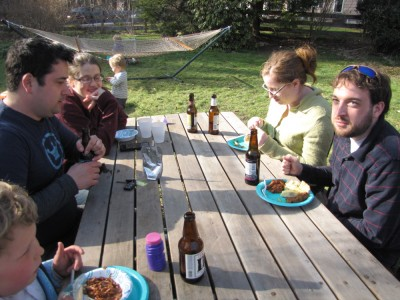 a few friends eating at the picnic table outside