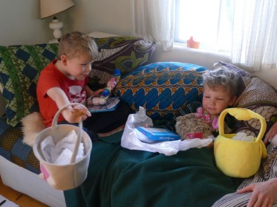 Zion and Lijah on the couch with Easter baskets