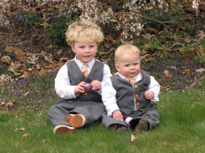 Harvey and Zion posing in their Easter suits below the flower tree