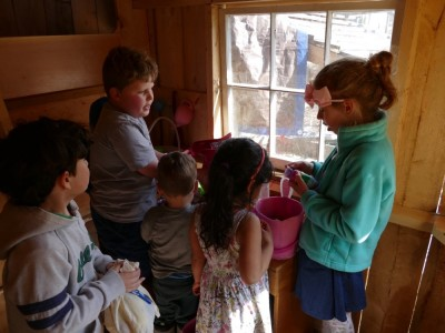 kids trading egg prizes in the playhouse
