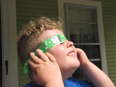 Harvey looking at the eclipse through the special glasses