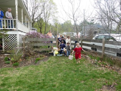 kids rushing into the yard to begin the egg hunt