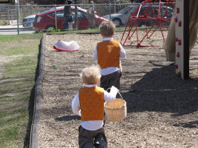Harvey and Zion running to find eggs in the church playground