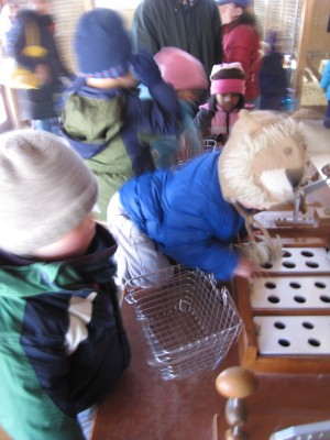Harvey and lots of other kids sorting eggs at Drumlin Farm