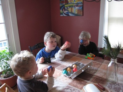 the boys at the kitchen table with dyed hard-boiled eggs and binoculars (?)