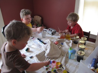 the boys decorating eggs at the kitchen table