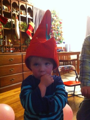 Zion in an elf hat at a birthday party