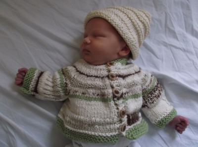 elijah wearing mama-knitted sweater and hat