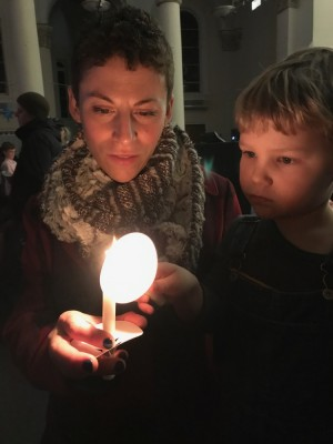 Leah and Lijah with candles at the Christmas Eve service
