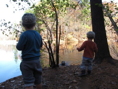 the boys on the shore of the pond, watching Rascal in the water