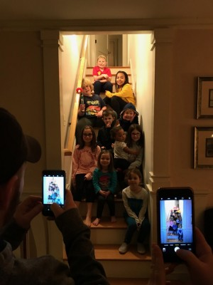 the boys and their cousins sitting on the stairs for a picture