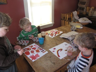 the boys painting at the kitchen table