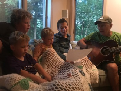 Leah and the boys singing with Grandpa Ira on the guitar