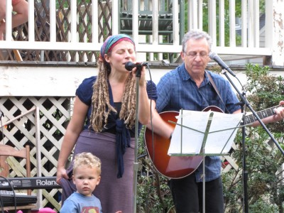 Leah and Grandpa Ira performing on stage, with Lijah alongside