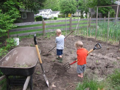 Zion and Lijah working in the garden