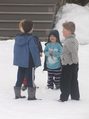 Harvey and Zion and friends standing in the snow