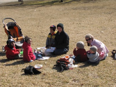 the archibalds and friends picnicking with coats on
