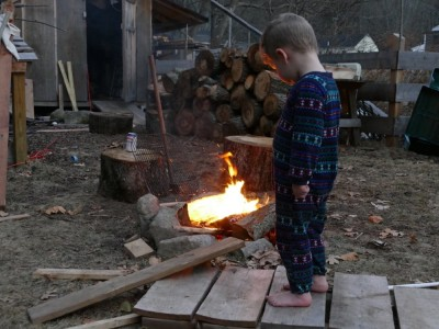 barefoot lijah watching the fire
