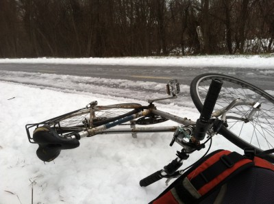 my bike and backpack fallen by the side of the icy bike path