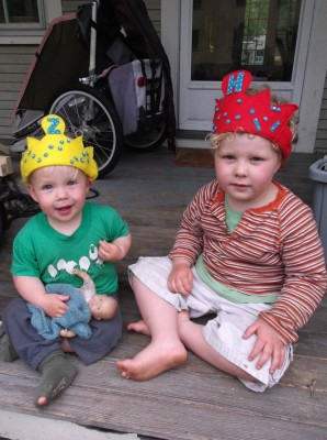 Harvey and Zion sitting on the porch in their felt crowns