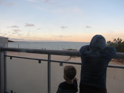 Harvey and Lijah on the hotel balcony watching the morning
