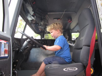 Harvey in the cab of a fire truck