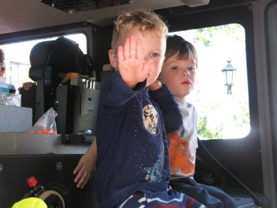 Lijah and Liam in a fire truck