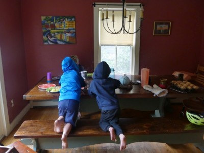 the boys at the breakfast table in sweatshirts