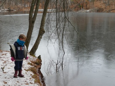 Lijah looking at a partially frozen pond