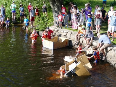 young people launching and sinking cardboard boats