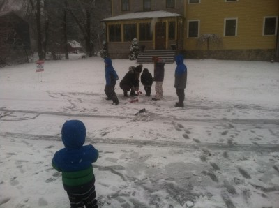 playing in the snow in front of the house