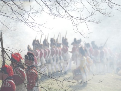 redcoats forming up in a haze of gun smoke