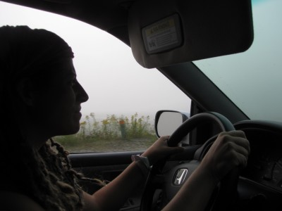Leah driving the car through the fog
