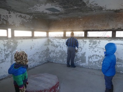 the  boys checking out an observation tower in the fort