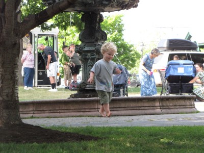 Harvey running back from the fountain in the park