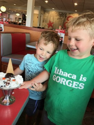 Zion and Lijah looking at an ice cream sundae at Friendly's