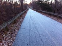 tracks in the heavy frost (or light snow) on the bike path
