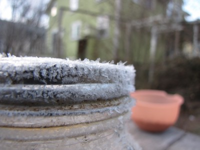 built-up frost on the metal ring of a jar outside