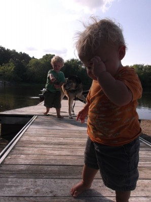 the boys playing on the dock