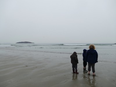 the boys by the shore at Good Harbor beach under gray skies