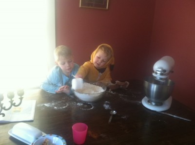 Zion and Lijah making gingerbread