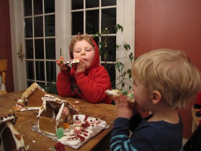 Harvey and Zion eating roof panels off their gingerbread houses