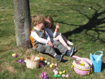 Harvey and Taya sitting together by the tree, surrounded by empty eggs
