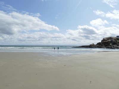 the boys far away on a cold-weather beach