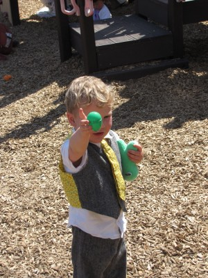 Lijah holding up an egg on the church playground