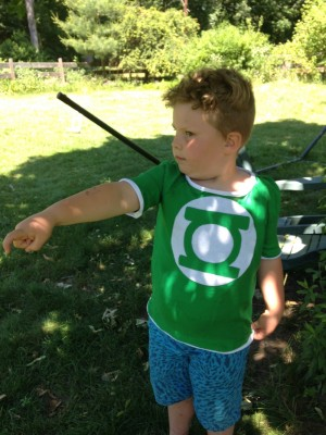 Harvey in his newly-made Green Lantern shirt, using his power ring