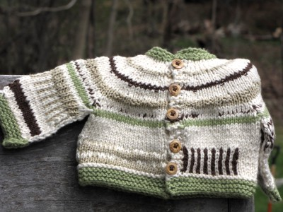 white, green, and brown sweater