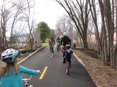 kids and grownups riding on the bike path