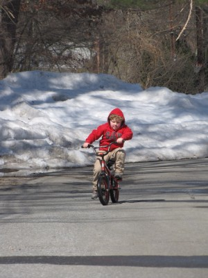 Harvey riding his bike towards the camera--no training wheels!