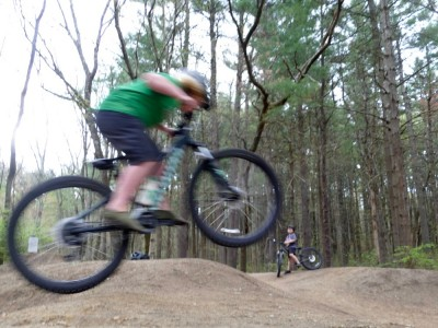 Harvey jumping his bike on the pump track